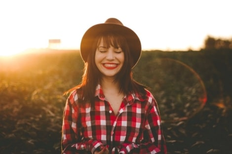 happy woman in plaid shirt