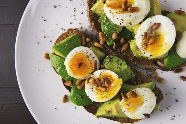 soft boiled eggs on toast with avocado
